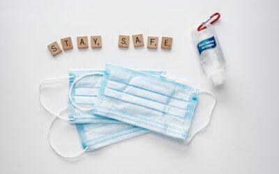 hand-sanitizer-face-masks-and-letter-tiles-spelling-safe-hands