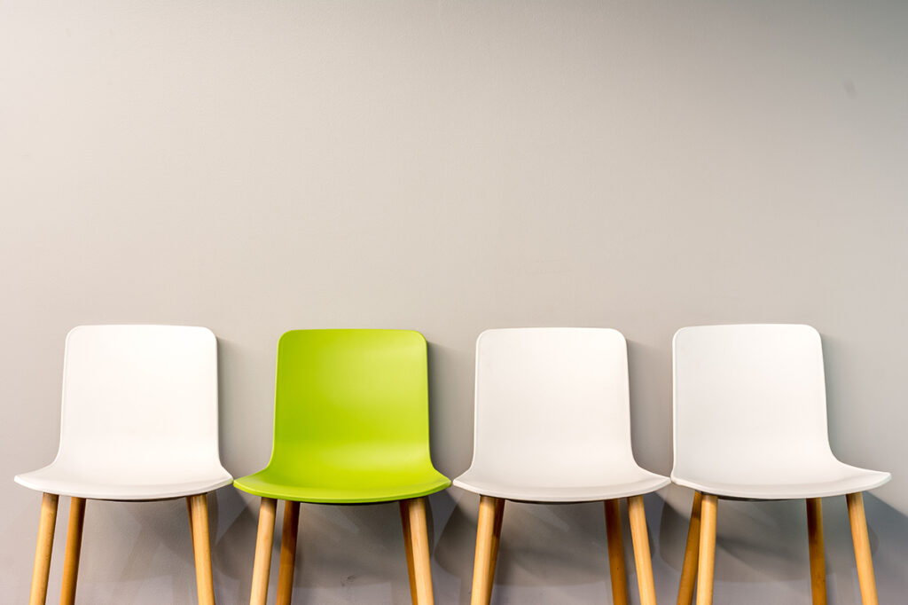 four chair lined up against a wall