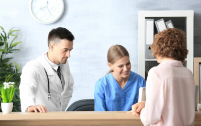 Doctor and nurse talking to a woman